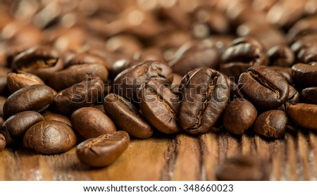 coffee beans on a wooden background - stock photo