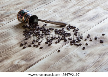 Coffee beans on the table - stock photo