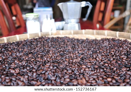 coffee beans on tray. - stock photo