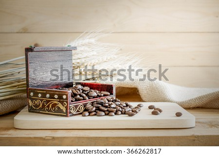 Coffee beans on wooden background. - stock photo