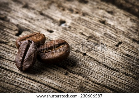 "Coffee Beans on wooden background ""shallow depth of field - stock photo"