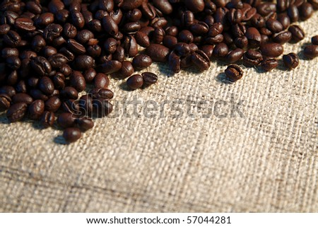 Coffee beans spilling from a burlap sack and fresh coffee - stock photo