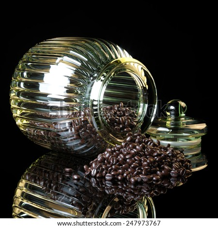 Coffee beans spilling out vintage glass jar on black background with reflection  - stock photo