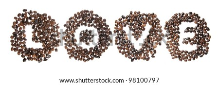 Coffee beans used to spell the word love. Isolated on a white background - stock photo