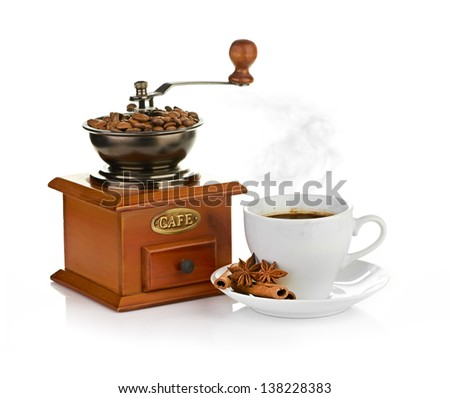 coffee beans with wooden coffee grinder and coffee cup. - stock photo