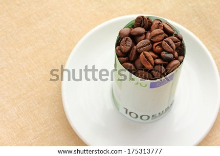 Coffee beans wrapped with 100 Euro Banknote - stock photo