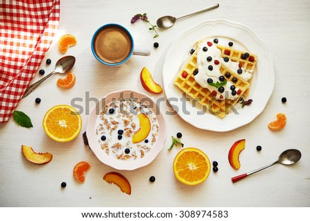 coffee, belgium waffles, corn flakes with milk and fruits. top view - stock photo