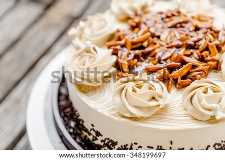 coffee cake with almond nut and butter cream - stock photo