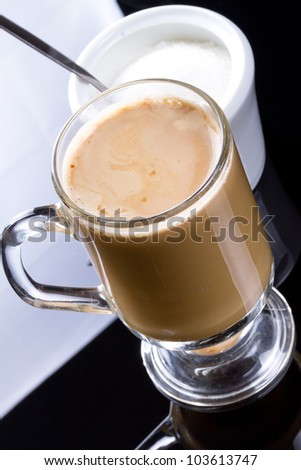 Coffee cappuccino in glassy mug - stock photo