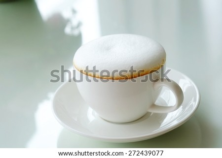 Coffee , cappuccino with a white cup , fluffy white milk on top. - stock photo