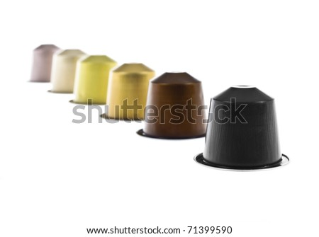 coffee capsules line with different colors isolated on white - stock photo