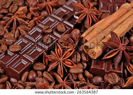 Coffee, chocolate, star anise and cinnamon sticks  - stock photo