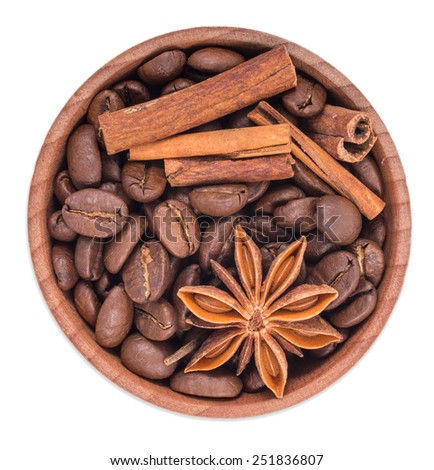 Coffee, cinnamon and star anise in a wooden bowl isolated on white background top view. - stock photo