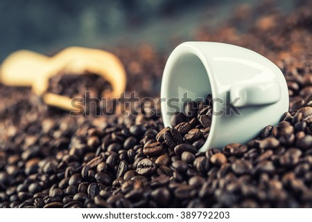 Coffee. Coffee beans. Coffee cup full of coffee beans. Toned image. - stock photo