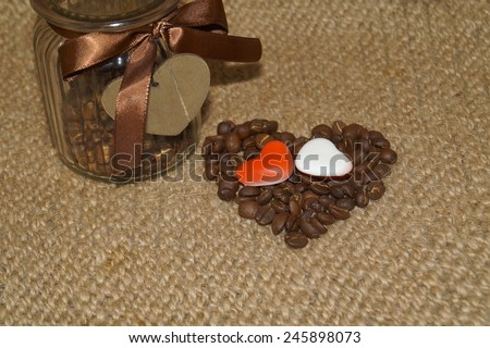 Coffee - coffee beans in the shape of heart - Valentine's Day in the kitchen - stock photo