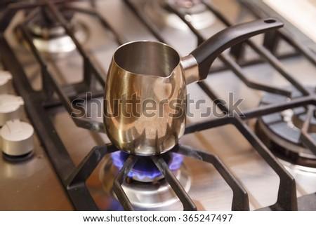 Coffee. Coffee pot coffee on a gas stove. - stock photo