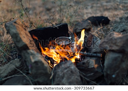 coffee cooked over a campfire on the nature - stock photo