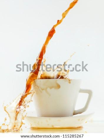 Coffee crown splash in mug - stock photo