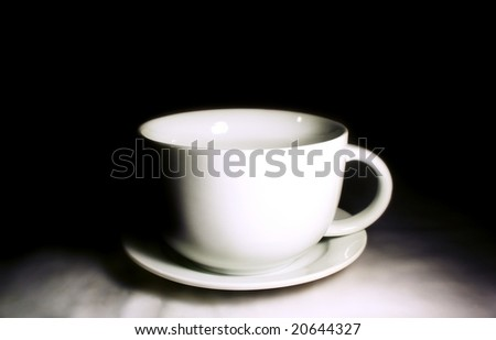 coffee cup against dark background - stock photo