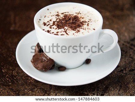 Coffee cup and chocolate - stock photo
