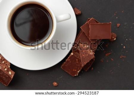 coffee cup and chocolate bar - stock photo