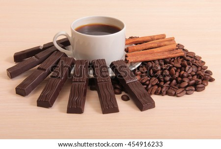Coffee cup and chocolate on a wood background - stock photo