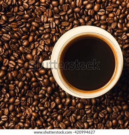 Coffee Cup and Coffee Beans Background./Coffee Cup and Coffee Beans Background - stock photo