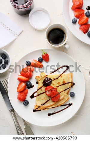 coffee cup and crepes, breakfast food - stock photo