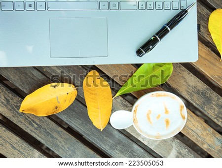 Coffee cup and laptop for business. - stock photo