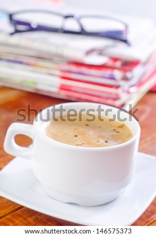 coffee cup and newspaper - stock photo