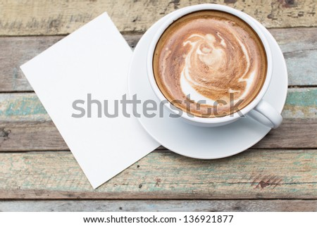 Coffee cup and paper on grunge background - stock photo