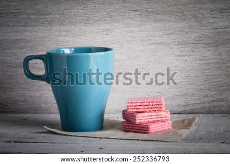 coffee Cup and Pink waffles with filter effect retro vintage style - stock photo