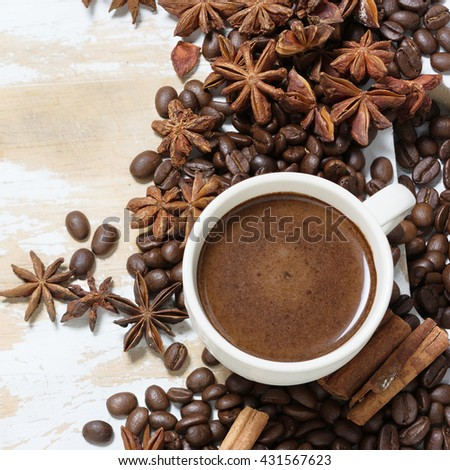 Coffee cup and roasted beans on the white wooden table. Organic food. - stock photo