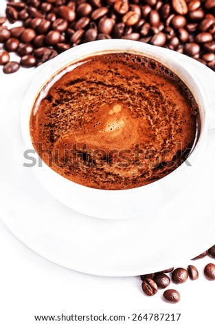Coffee cup and saucer with roasted coffee beans isolated on a white background - stock photo