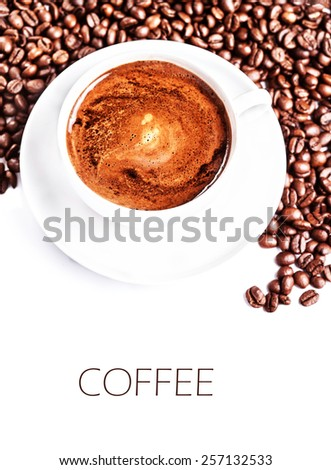 Coffee cup and saucer with  roasted coffee beans isolated on a white background, close up (with sample text) - stock photo