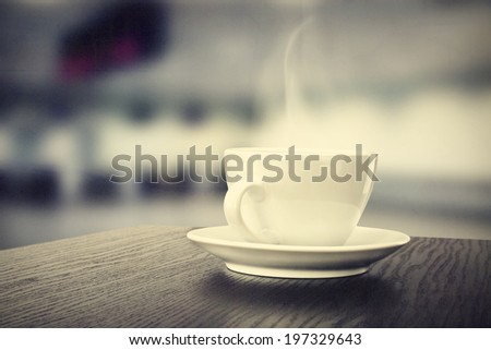 coffee cup and silver background  - stock photo