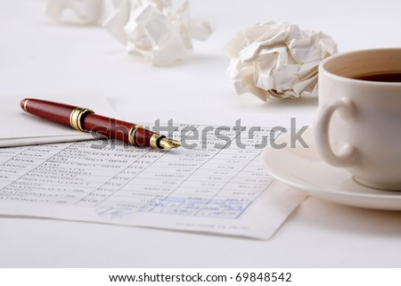 Coffee cup and spiral notebook and pen on the wooden table - stock photo