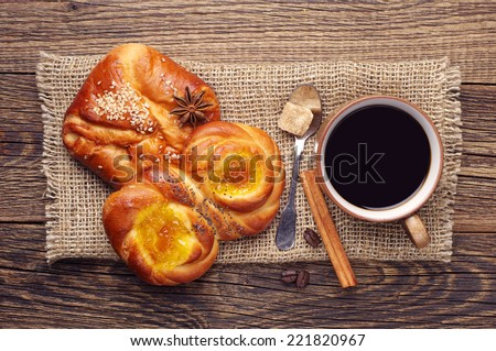 Coffee cup and sweet buns on vintage wooden table. Top view  - stock photo
