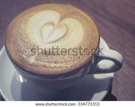 Coffee cup cappuccino on table Vintage style tone - stock photo