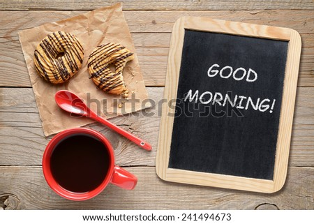 Coffee cup, cookies and small blackboard with Good morning! phrase - stock photo