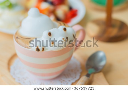 Coffee cup frothed milk cute teddy bear 3D art drink? - stock photo