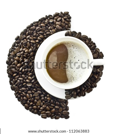 Coffee cup in an environment of Coffee beans - stock photo