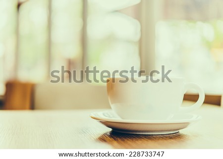 Coffee cup in coffee shop - vintage effect style pictures - stock photo