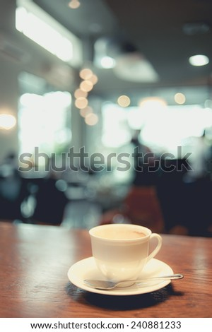 Coffee cup in coffee shop - vintage instagram effect filter - stock photo