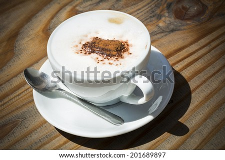 Coffee cup in sunshine - stock photo