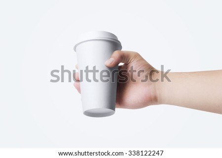 coffee cup MockUp in hand - stock photo