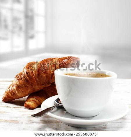 coffee cup of white color and croissants  - stock photo