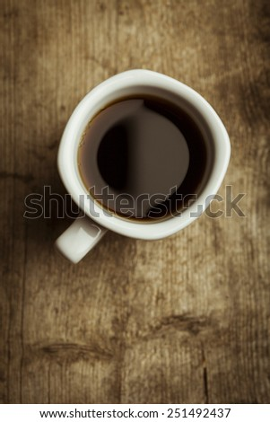 Coffee cup on a wooden background - stock photo