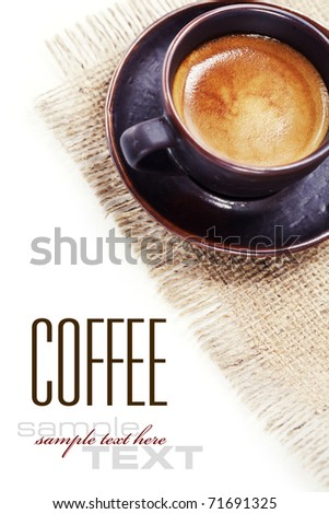 coffee cup on burlap with sample text - stock photo