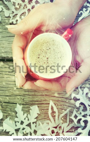 Coffee cup on the snowflake background - stock photo